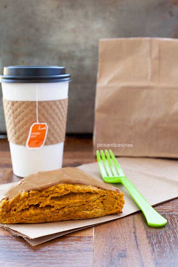 Recipe for pumpkin scones topped with a mapleu infused cream cheese glaze.